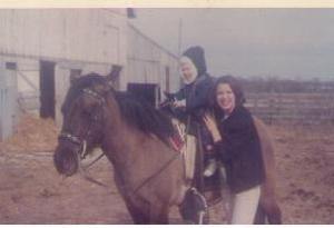 1968: That's me, with the barn in the background. That's a good friend of our family's, and I think that's her horse, not Dad's.