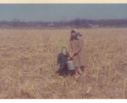 1968: Mom and me in the field. What, am I EATING the corn we're gleaning?!