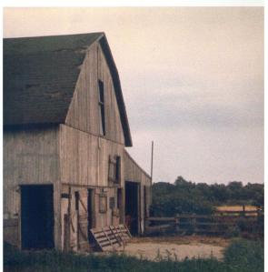 "My barn: this photo was taken by my Cousin Steve either when I was a baby or before I was born; the barn as seen here is in slightly better shape than it was during most of our ""glory days."""